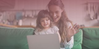 Mom and daughter smiling at video chat on laptop during a remote check-in