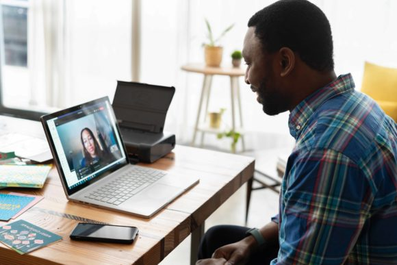 Man having a remote conversation with a team member