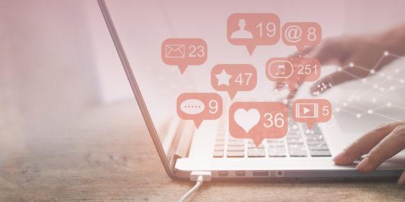 Social media notifications rising from laptop