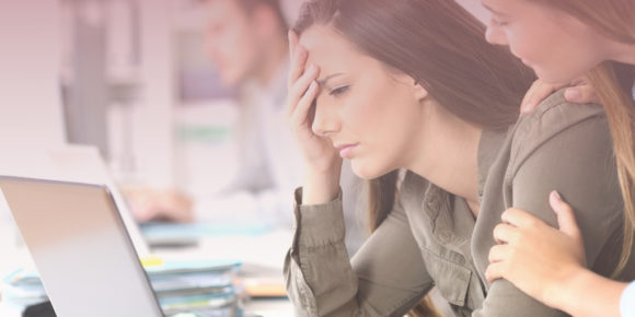 Woman looking frustrated after making a mistake
